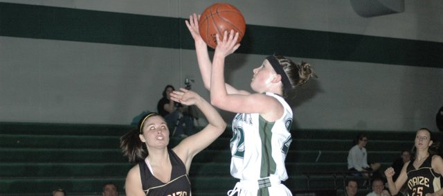 Shelbi Petty drives in for a layup during the first half against Maize South. Petty scored 17 points in the game.