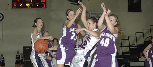 Katie Slavin (12) and Molly Brunton (32) battle for a rebound during the second half against Baldwin Tuesday at Eudora. The girls fell to their rivals 51-31.