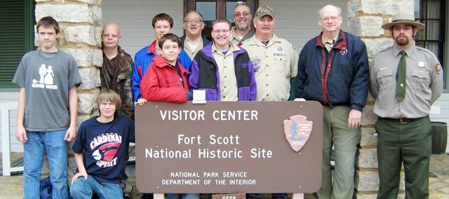 Members of Eudora Boy Scout Troop 64 stand in front of a sign marking the Fort Scott National Historic Site.