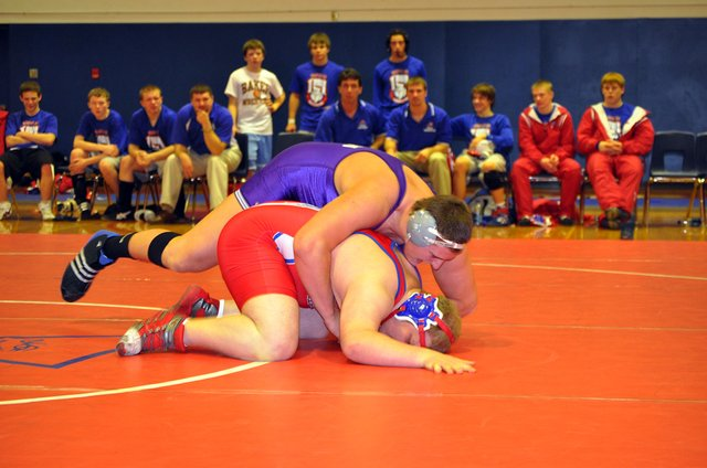 Baldwin High School junior Jesse Austin, top, pinned Santa Fe Trail's Ethan Kahle in the 285-pound match last Thursday to help the Bulldogs win their third dual of the season.