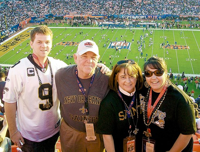 Baker University senior Mack Brown, left, traveled to Miami with his family to cheer on the New Orleans Saints at the Super Bowl. He is pictured here, before the game, with his family. They are, from left, father Sam, mother Cindy and sister Maggie, who is a 2004 Baker graduate.