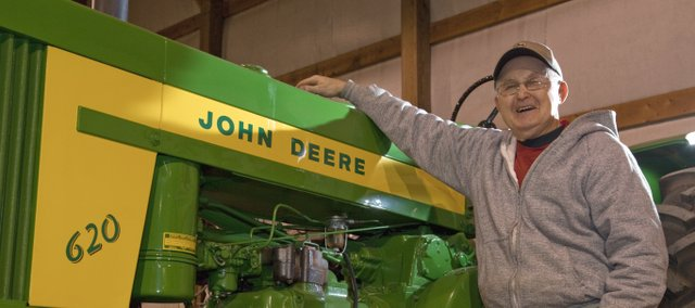 Thurman Duncan finds relaxation from the restoration of antique John Deere tractors. His growing collecting is annually on display at the De Soto Day Parade.
