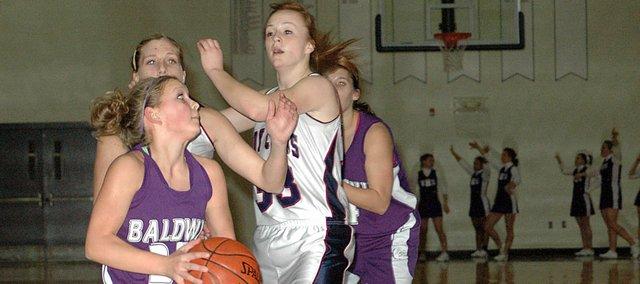 Baldwin High School freshman Kailyn Smith drives to the basket past two Eudora defenders Tuesday night. Baldwin won the game 51-31.