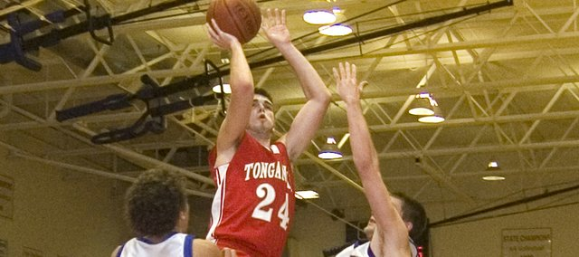 Tonganoxie High senior Keaton Schaffer goes up for a shot against Santa Fe Trail on Friday night. The Chieftains lost at Carbondale, 67-58.