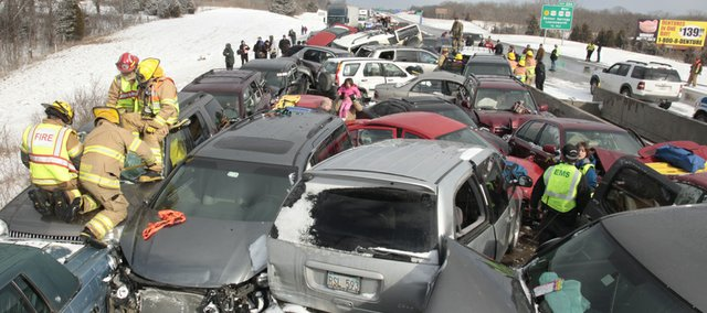Paramedics and firefighters worked for hours to free motorists trapped in their cars after sudden winter weather caused vehicles to pile on top of each other Sunday on Interstate 70 near Bonner Springs.