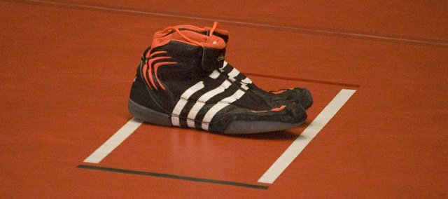 The shoes of former Tonganoxie High wrestler Jeremy Elliott were retired in a Senior Night ceremony Thursday night at THS. Elliott, who died April 17, 2009, would have been a senior on the Chieftains wrestling team this season.