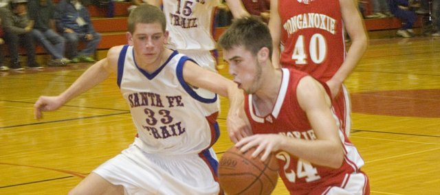 Tonganoxie High senior forward Keaton Schaffer drives against Santa Fe Trail on Friday night. The Chieftains lost at SFT, 67-58.