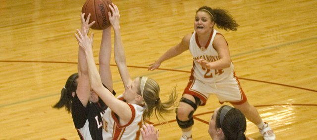 Tonganoxie High senior guard Lauren Hall runs into trouble while trying to drive against Lansing on Tuesday night. The Chieftains lost to the Lions, 57-41.