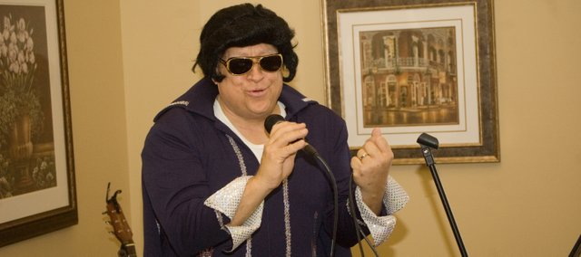Rev. Francis Stockton performs as Elvis Presley recently at Vintage Park in Tonganoxie. Stockton said he&#39;s not an Elvis impersonator, but rather performs as a clown character based on Elvis.