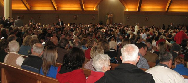 Seats quickly fill at Sunday's dedication ceremony of the new Holy Angels Catholic Church. More than 1,000 people attended the event.