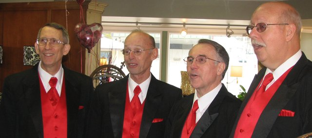 Purely Harmonic quartet members Bill Krondak (far left), Brad Cox, Jim Bliss and Al Fehlauer deliver a singing Valentine Saturday at Leavenworth Floral and Gifts in Leavenworth. The group performed for people in the Leavenworth County community during Valentine's weekend.