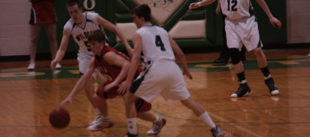 Mason Wedel (4) and Aaron Nutterfield (50) defend against Ottawa Friday at De Soto. The Wildcats lost the game 50-47.