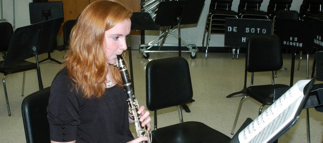 Katie McKeirnan practices Tuesday in the De Soto high school band room. Katie, a junior, will travel to New Mexico in March to compete in the national finals of the Music Teachers National Association woodwind competition.