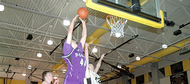 Baldwin High School junior Justin Vander Tuig scores two of his 30 points Tuesday night at Paola. BHS lost to the Panthers, 64-53.