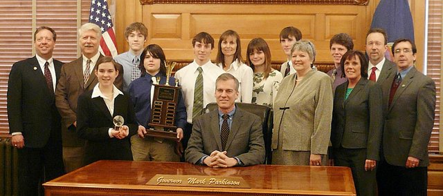 Gov. Mark Parkinson, center, awards students from Baldwin High School for winning the 2010 Real World Design Challenge. From left to right, Sen. Tom Holland, D-Baldwin City, RJ Dake, Carrie Deitz, Mason Johnson, Mac Halpin, Carson Barnes, advisor Sandy Barnes, Shelby Gregory, Austin Kraus, advisor Pam Davis, Brandon Baltzell, Interim Commissioner of Education Diane M. DeBacker, Tom Foster and Rep. Tony Brown, D-Baldwin City.