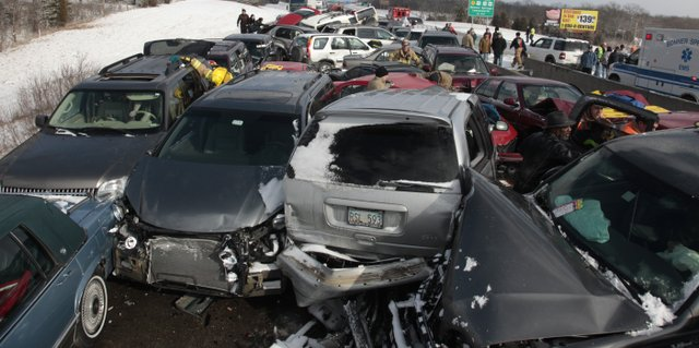 Vans, SUVs and cars were collapsed into a mass of glass and metal after a massive accident Sunday on Interstate 70 near Bonner Springs. the westbound lanes of the highway were shut down for hours while emergency crews tried to free trapped passengers and clear the accident.