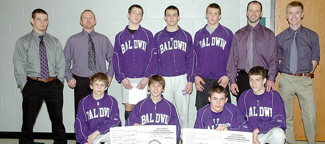 Baldwin High School qualified seven wrestlers for the Class 4A state tournament in Salina next weekend. They each finished at the top four of their weight class at the regional tournament Saturday in De Soto. Front row, from left, are sophomore Andrew Morgan, freshman Bryce Shoemaker, senior Josh Hanson and junior Colby Soden. Back row are assistant coach Nick Rockhold, assistant coach Kip Clark, junior Greg Schiffelbein, junior Will Von Bargen, senior Heath Parmley, head coach Kit Harris and assistant coach Joel Eberhart.