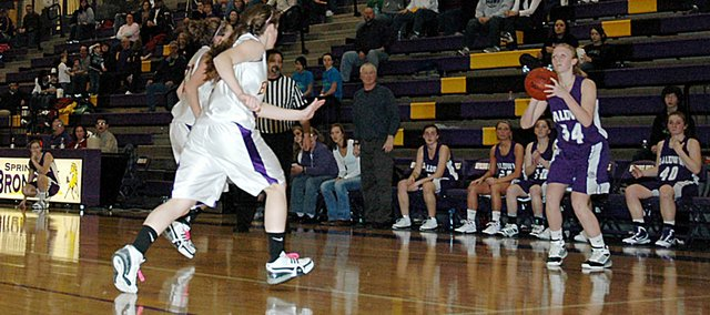 Baldwin High School senior Taylor Brown, right, attempts a three-pointer Friday night at Spring Hill. Brown sank four three-pointers to help BHS beat the Broncos 67-56.