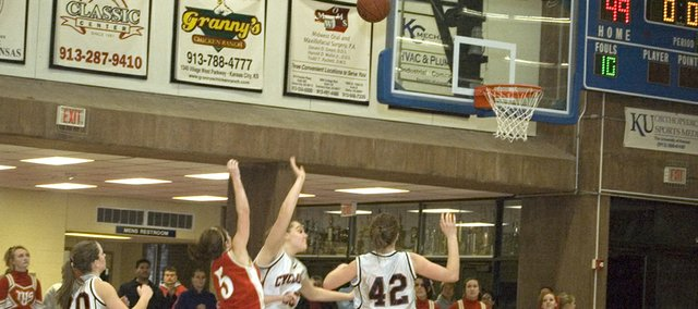Andie Jeannin releases a jumper just before the final buzzer in Tonganoxie High's 49-47 loss to Bishop Ward in Kansas City, Kan., on Friday. The potential tying shot rimmed out as time expired.