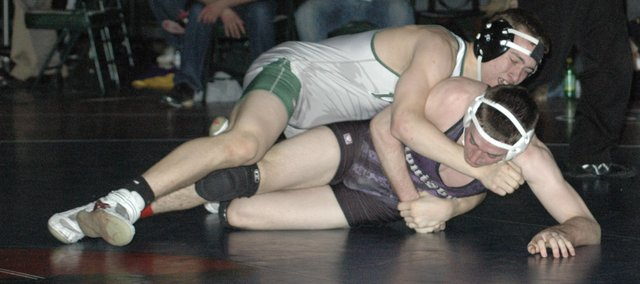Cole Cannon wrestles during a 160-pound match against Louisburg's Mason Whaley at the regional tournament in De Soto. Cannon won the match and the regional championship. Cannon and teammate Donny Parr (189) qualified for this weekend's state tournament in Salina.