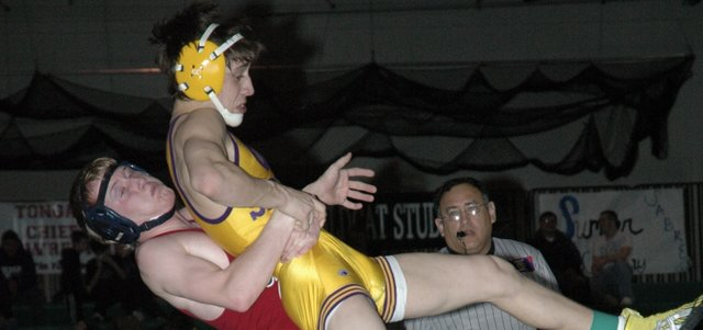 Eudora senior Thomas McLees lifts Spring Hill's Michael Nemer in the 119-pound regional championship match Saturday at De Soto. McLees won the match 3-2. Eudora finished second as a team at regionals and qualified seven wrestlers for this weekend's state tournament in Salina.