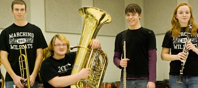 Alex Crall, senior, Derek Smith, junior, and Tommy Strauser, junior will be traveling to Wichita to perform in the 1-4A All State Band. Katie McKeirnan, junior, will be playing in the Kansas All-State Orchestra in Wichita.