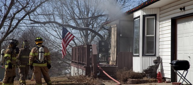 Fire crews battle a house fire in Eudora Wednesday, Feb. 24.