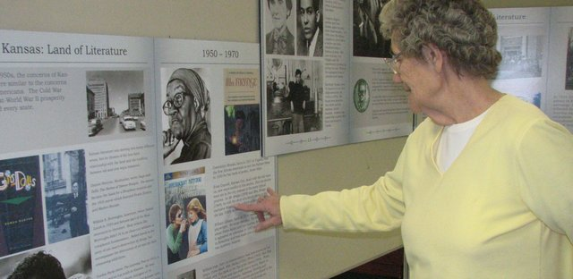 "Anna Jean Breuer discusses some of the information displayed in the Basehor Historical Museum's newest exhibit, ""Kansas: Land of Literature."""