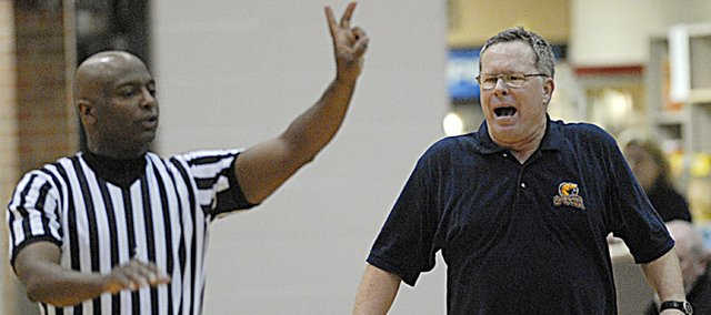 Baker University head basketball coach Rick Weaver, shown in this file photo questioning a referee's call, will coach his last home game tonight at 7:30 in Collins Gym. Weaver announced his retirement from coaching in December. He is the all-time leader in wins for men's basketball at Baker. A reception will follow the game at the Lodge.