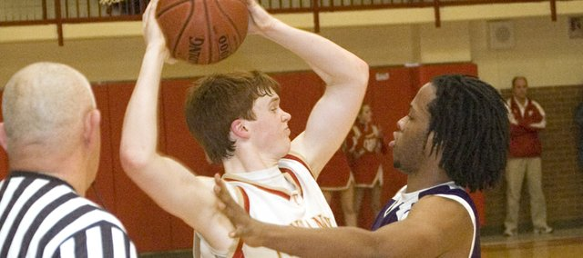 Dane Erickson gets an up-close look at Piper's physical defense in the fourth quarter of Tonganoxie High's 68-62 win over the Pirates on Friday.