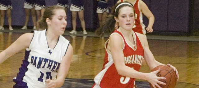 Tonganoxie High senior guard Andie Jeannin attacks Royal Valley's zone Monday night at Hoyt. The Chieftains' season came to an end in the Class 4A sub-state first-round contest, which THS lost, 62-50.
