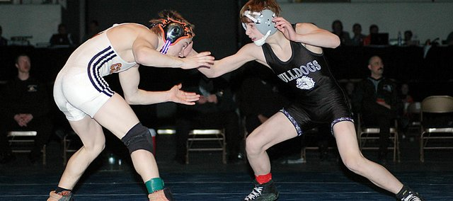 Baldwin High School freshman Bryce Shoemaker, right, won the 103-pound state championship Saturday evening in Salina. He is the fifth state champion and highest state finisheras a freshman ever at BHS.