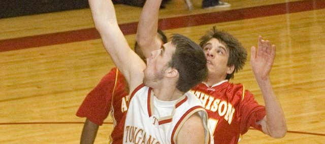 Tonganoxie High senior forward Keaton Schaffer swoops in for a layup as the Chieftains hammered Atchison, 74-48, Tuesday in a sub-state opener at THS.