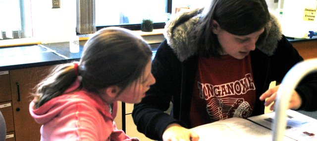 Two Tonganoxie students work during the Science Olympiad Saturday at Johnson County Community College.