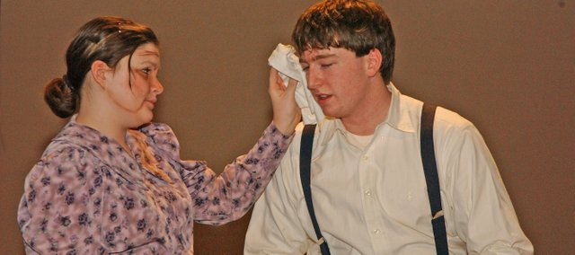 "Courtney Goodin as Ma Joad comforts her son Tom, played by Derrick Mathern, in a scene for the De Soto High School play ""The Grapes of Wrath."" It is one of two plays with ""Steel Magnolias"" De Soto High School students are performing this week."