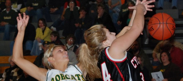 Shelby Equels, left, had two early steals and set the tone for the Basehor-Linwood defense in its 38-33 victory against Bishop Ward in the first round of the Class 4A substate tournament.