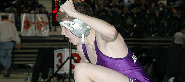 Baldwin High School junior Colby Soden lets out a yell after defeating Eudora's Tim Wright Saturday morning in the consolation bracket. Soden trailed 10-2 with 1:20 remaining in the match,  but came back to win 13-10.