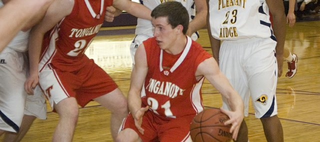 Tonganoxie High junior point guard Jeremy Carlisle penetrates against Pleasant Ridge's defense on Friday at Hoyt. The Chieftains lost the sub-state semifinal, 64-61, despite 24 points and five assists from Carlisle.