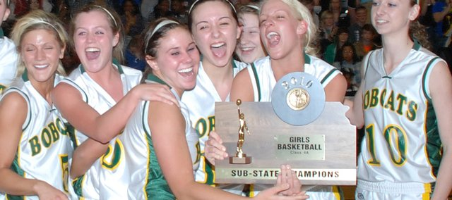 The Basehor-Linwood girls celebrate after receiving the Class 4A substate championship trophy. BLHS is headed back to state for the second time in three years.
