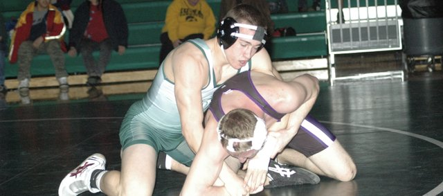 Cole Cannon, top, was one of two De Soto wrestlers to qualify for this year's state tournament. Cannon (160) and Donny Parr (189) both advanced to state and will return next year.