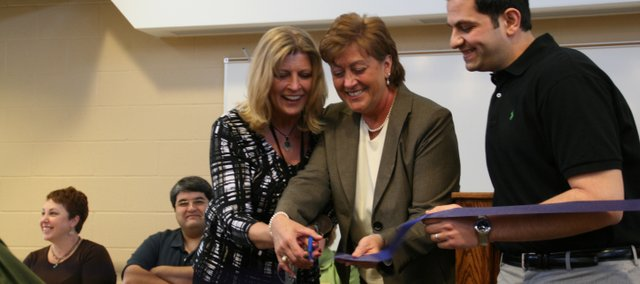 Basehor Elementary School 3-5 secretary Diane Kirk (left), principal Teri Boyd and Basehor Chamber of Commerce President Aladdin Ashkar (top photo) snip the school's ribbon Sunday.
