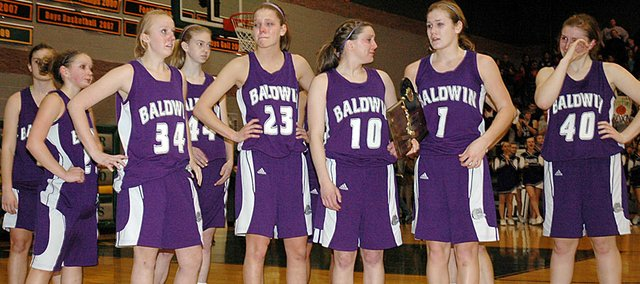 Baldwin High School's girls' basketball team accepted its sub-state runner-up plaque following Saturday's 46-37 loss to Basehor. The loss ended the Bulldogs' season and chance for a berth into the Class 4A State Tournament.