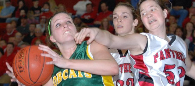 Basehor-Linwood junior forward Megan Bergstrom prepares to score on a put-back during the first half of the Class 4A state tournament first-round game against Concordia. Bergstrom scored 19 points in the Bobcats' 45-38 loss.