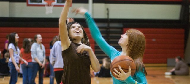 On Thursday, Breanna Puttman tries to block Misty Newton's shot during a game of duck duck goose basketball at Lexington Trails Middle School. The basketball games were a reward for the hard work the students had done for the annual Hoops for the Heart fundraiser.