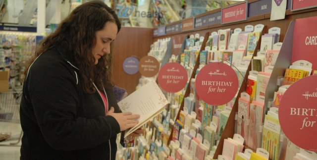 Kristen Hale, from Shawnee, peruses the selection of greeting cards at the new Walgreens in Bonner Springs. The store officially opened Friday, March 12. 