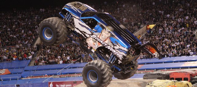 Jimmy Creten operates his monster truck Bounty Hunter during a show. Creten and his wife, Dawn, who drives Scarlet Bandit, will compete Friday and Saturday in Wichita's Intrust Bank Arena.