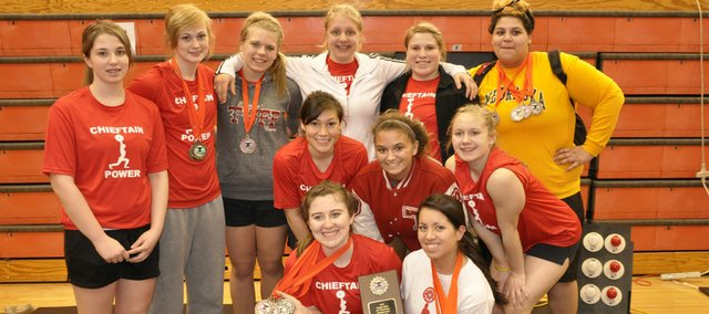 Tonganoxie High's girls powerlifters show off their medals and plaque after finishing third in the team standings at the Class 4A state powerlifting meet at Abilene on March 6. Pictured are: (front row) Ali George, Shelby Maxon, (middle row) Alex Hauk, Shyanne Gergick, Rebekah Adcox, (back row) Shelby McDaniel, Ashley Kotowske, Makayla Sample, Eva Drennan, Katelyn Colgrove and Domino Grizzle.