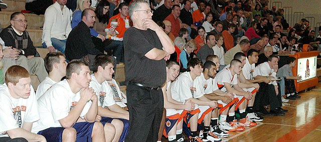 Baker University men's basketball coach Rick Weaver paced the Wildcats' sidelines for his final time at Collins Center Feb. 25. Weaver retired after 25 seasons as the Wildcats' head coach.