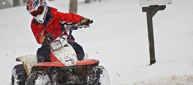 "Conner Schimke power slides on an ATV during Saturday's snow storm. ""It beats sledding,"" he said."