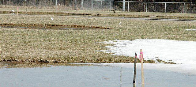 Baldwin High School's new varsity baseball field is battling the effects of a rainy year and a wintry snow as the field has standing water in several places. The field is near completion, but needs dried out before construction crews can finish the remaining tasks at the new complex.